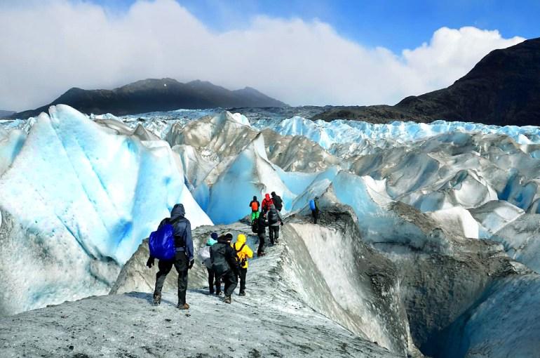 Hikers in crampons trekking on Viedma Glacier in Patagonia