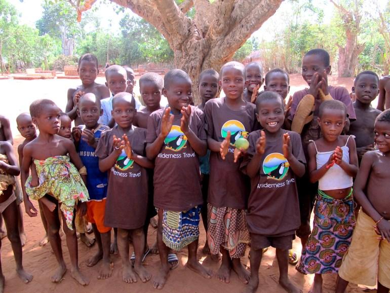 Children in Togo wearing Wilderness Travel T-shirts.