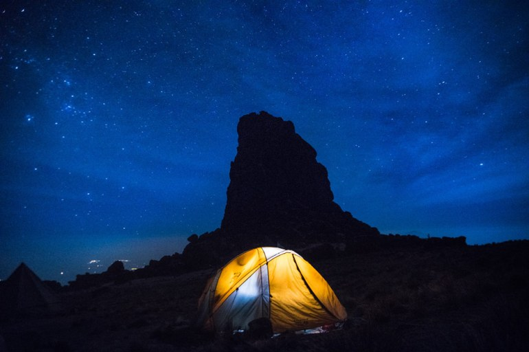 tent lit up against the silhouette of Lava Tower, Kilimanjaro