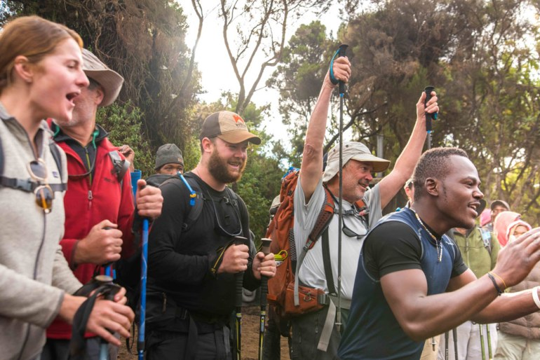 happy hikers who have completed Kilimanjaro trek