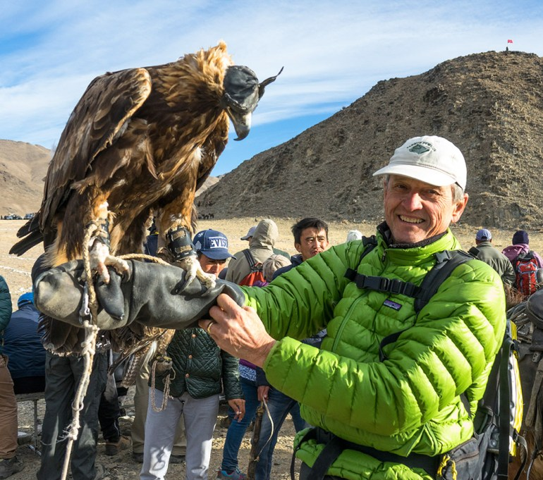 man holding golden eagle