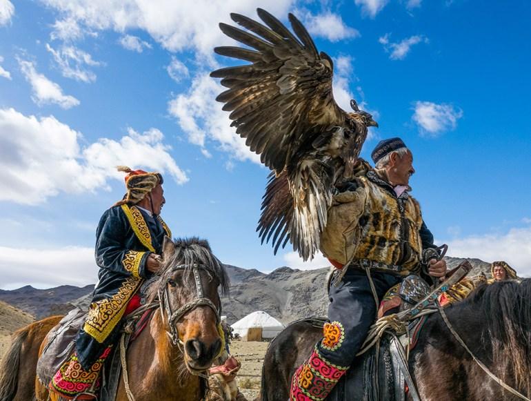 golden eagle festval men with eagle