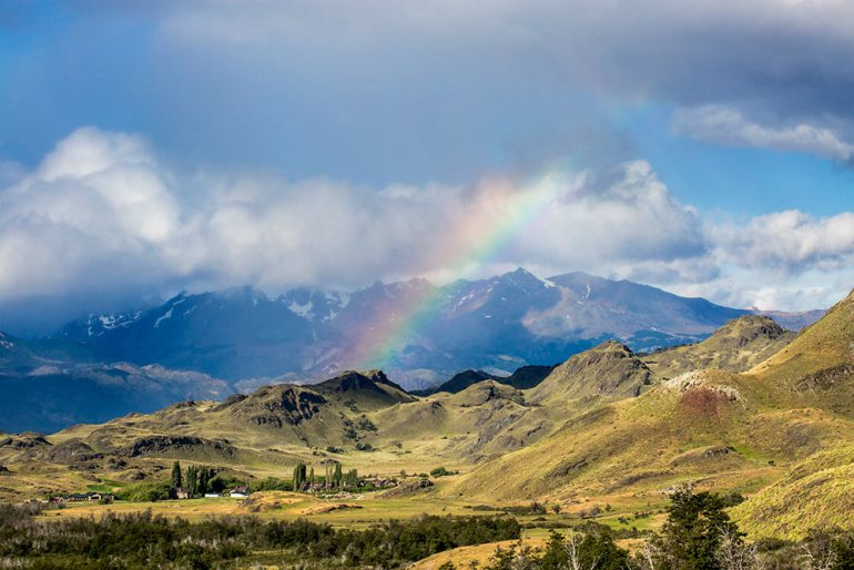 Rainbow over valley in Patagonia