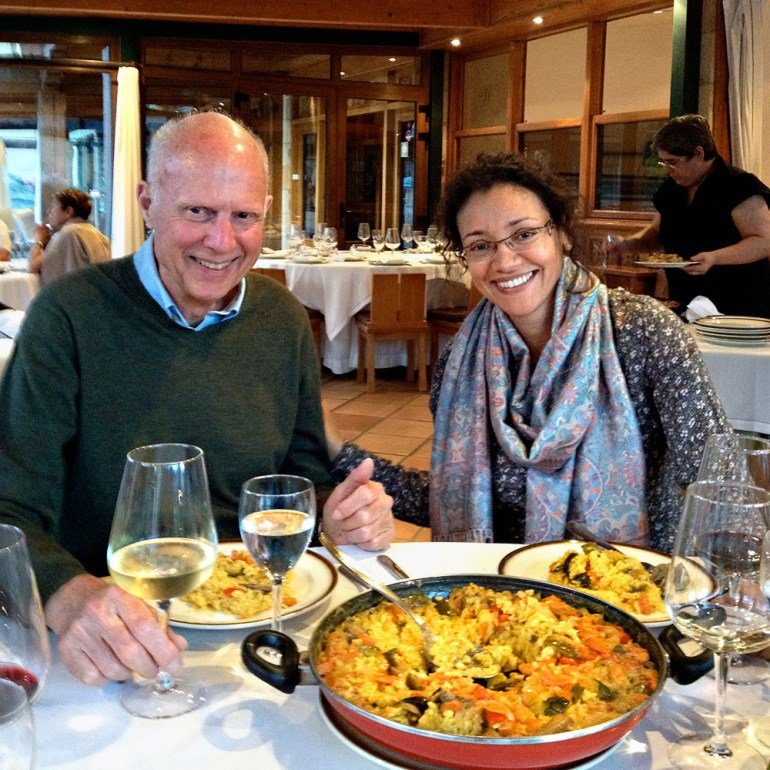 two people eating paeela at a restaurant
