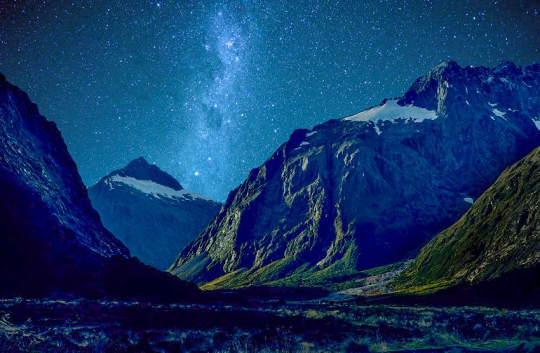 milford sound new zealand with stars