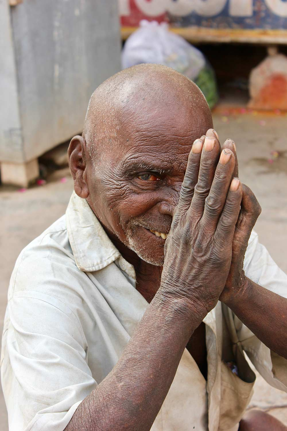 A man praying outside a Hindu temple in India