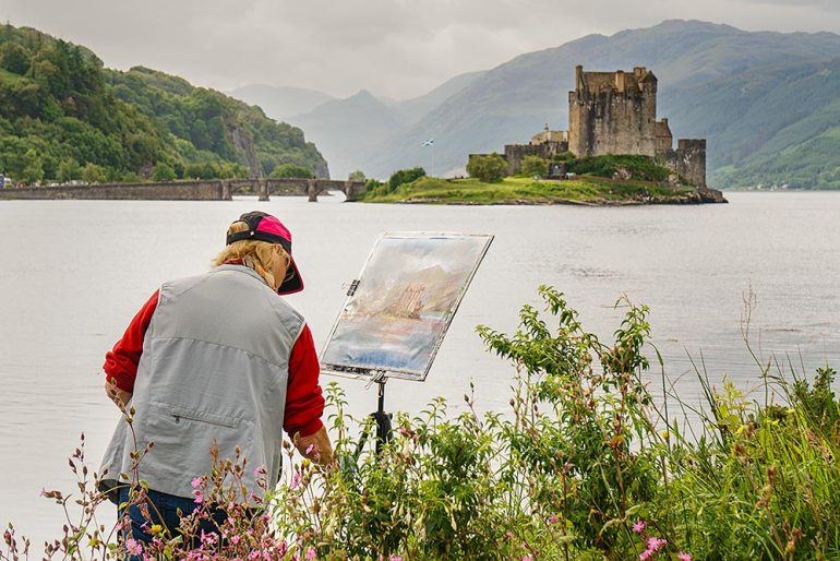 Painter at Eilean Donan Castle Scotland
