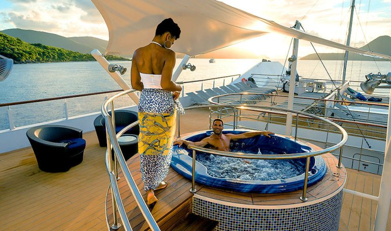 couple in a hottub on a cruise ship in the south pacific