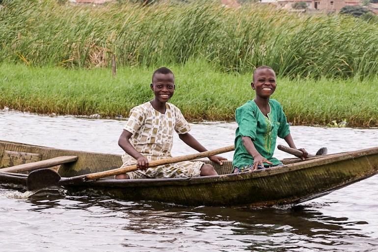 boys in boat Ganvie Benin