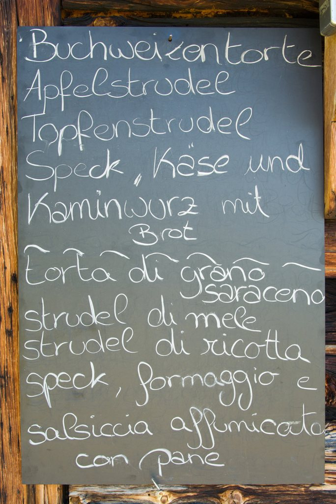 restaurant sign in the dolomites