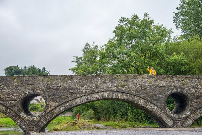Man on bridge in Snowdonia National Park, Wales