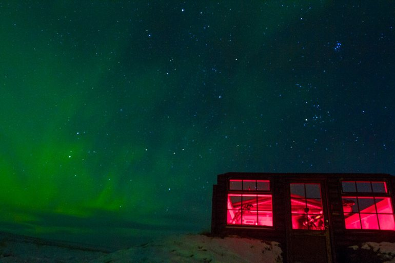 northern lights over hotel in iceland
