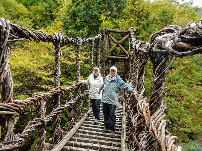 couple standing on bridge in Shikoku Japan