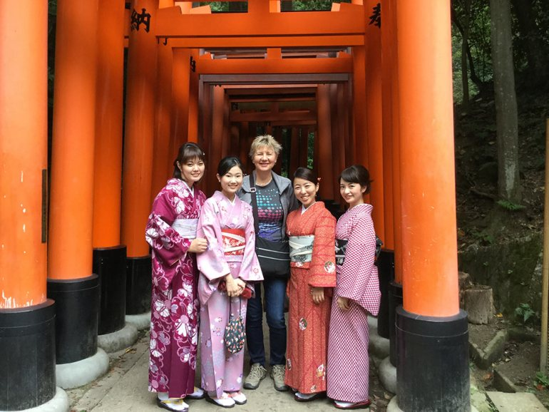 group in front of inari torii gates in Kyoto Japan