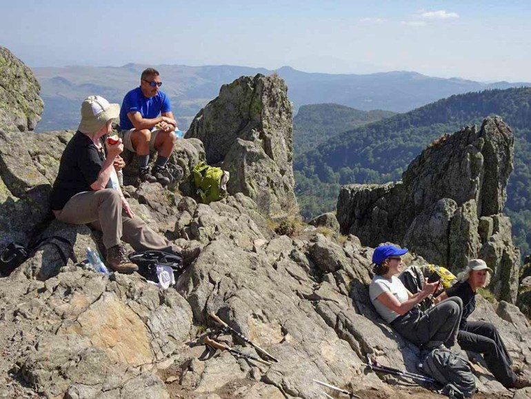 hikers resting on a mountain