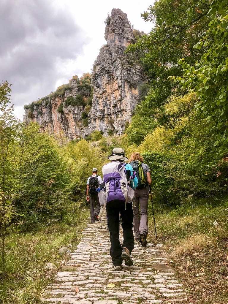 hikers walking on path in Greece