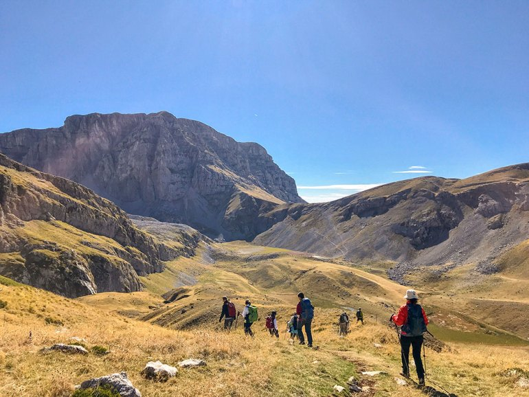 hikers walking through open landscapes in Greece