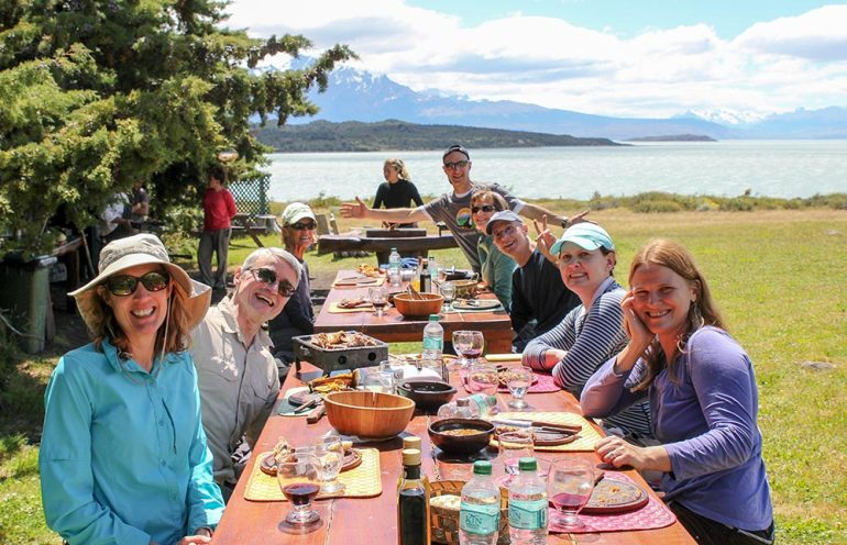 group eating a picnic at helsingfors estancia in patagonia