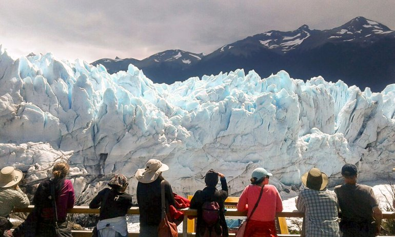 group standing in front of moreno glacier in patagonia