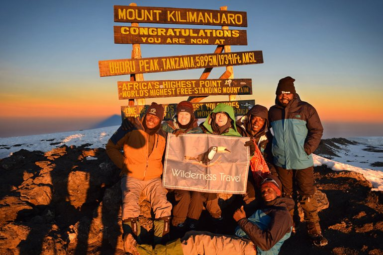 group photos at the top of the summit in kilimanjaro