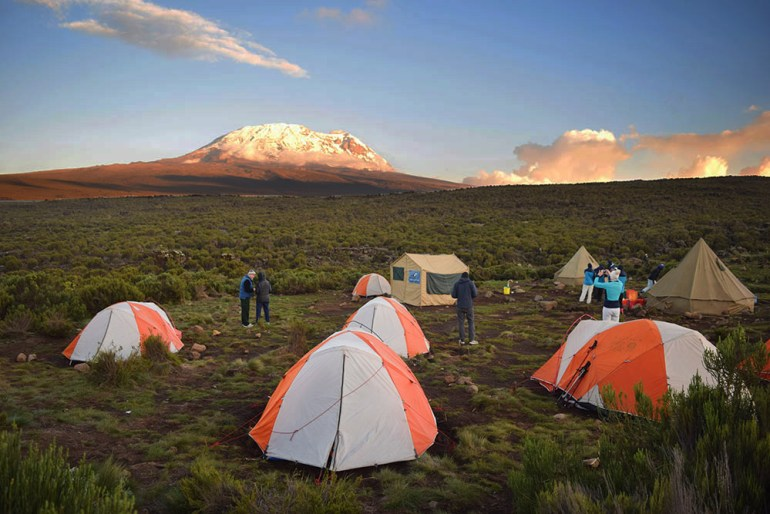 tents with the mountain in the background in kilimanjaro