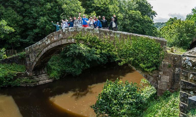 group on bridge in England