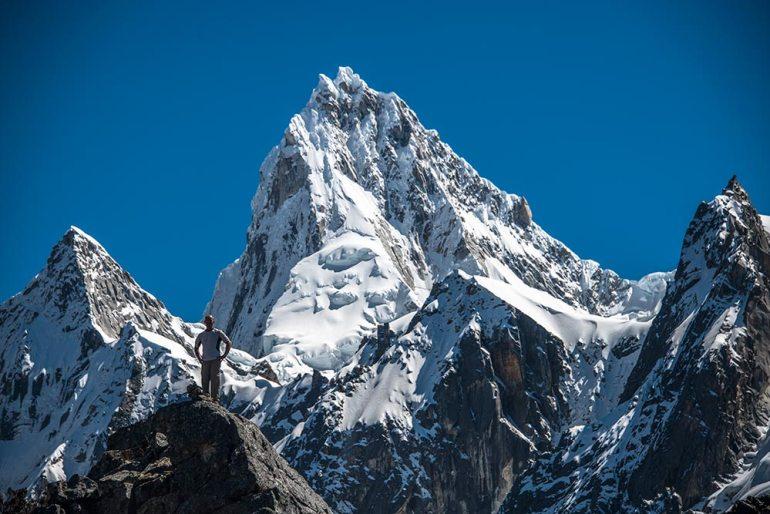 man and mountain in Cordillera Blanca