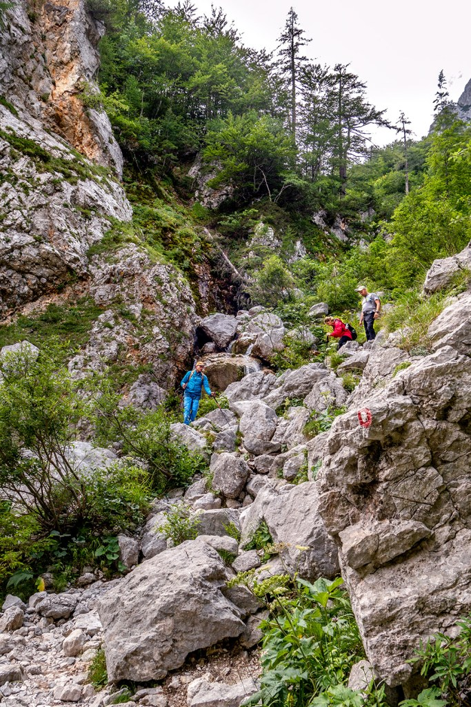 hiking over rocks in Slovenia