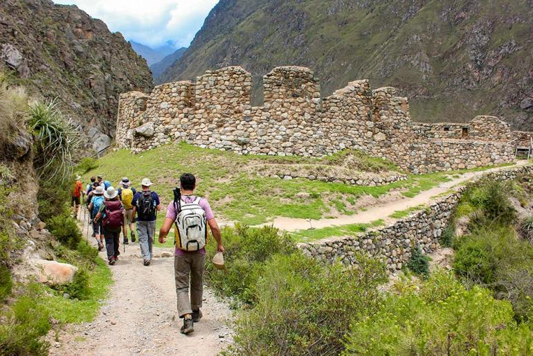 hiking past Inca ruins on the Inca Trail