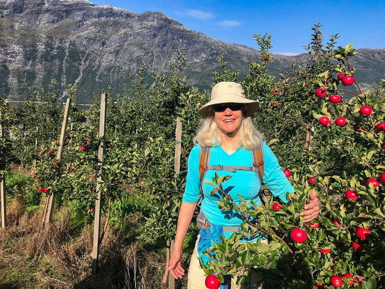 woman in apple orchard in Norway