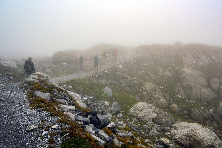 hiking through fog on mont blanc to mediterranean