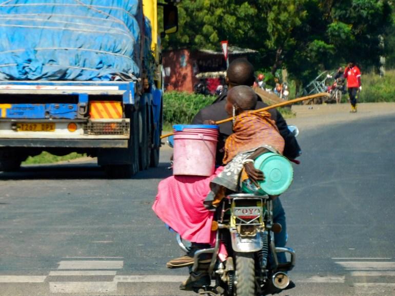 masaai lady getting a ride on a moterbike taxi in tanzania