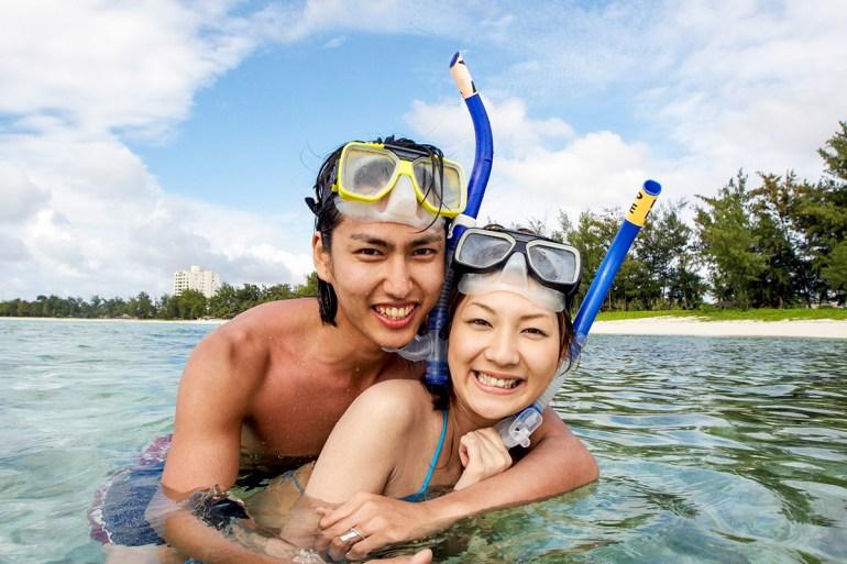 snorkelers smiling at camera