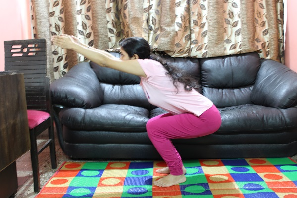 Utkatasana or Chair Pose