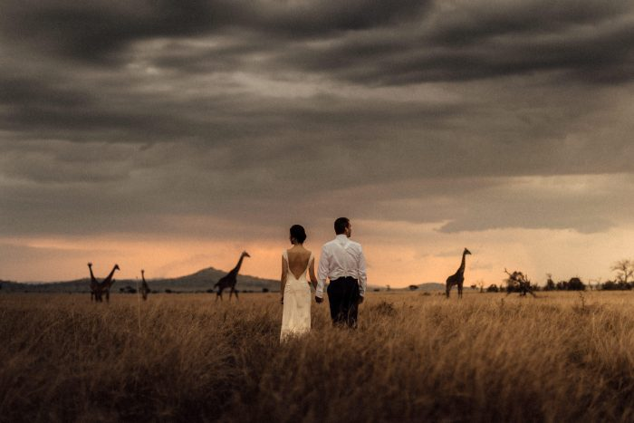 couple with giraffes