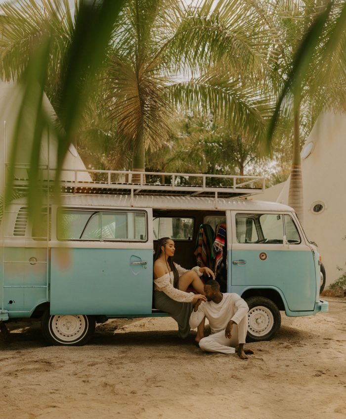 couple on beach in vintage VW bus