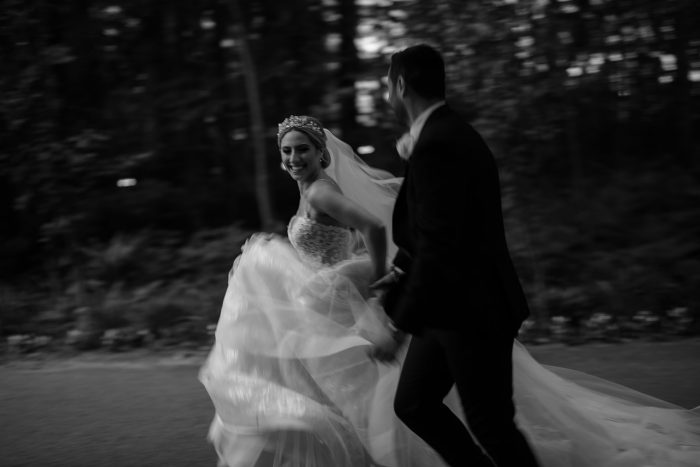 wedding day couple running down street