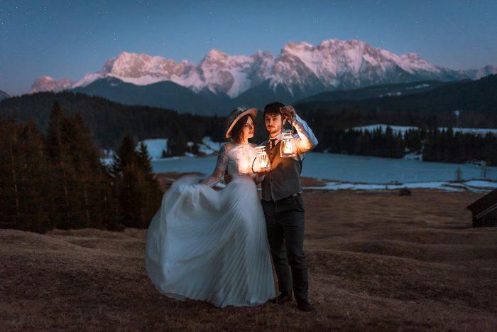 wedding portrait in mountains with lanterns