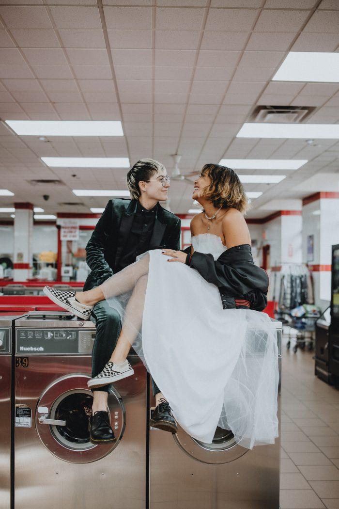 alternative wedding couple in laundromat