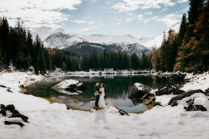 top pic of month couple among mountains and snow