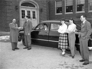 Mr Mortensen gets keys from Jim Baxter for new Ford 1952