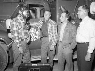 Irv Boor demoing newly arrived Scott Airpak to Jim Haraldsen, Bob Altman and Dave Haraldsen 1965