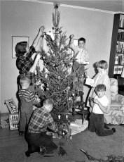 Crawford children decorate Xmas tree G'town 1958