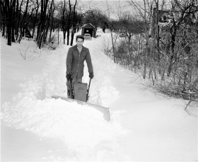 John Gunther plowing driveway Feb. 1958