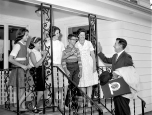 Dr. Andrew Ritter bids adieu to family when leaving for Europe 1964