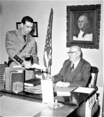Trooper consults with Gus Brenke Livingston 1958 (2)