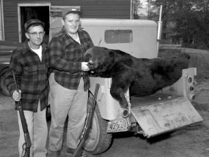 Claude Poucher & Sam Podmijersky with 250 lb black bear Linlithgo 1959
