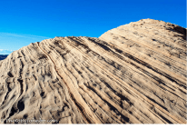 This sandstone monolith displays a beautiful natural sculpted surface