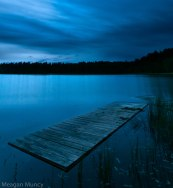 Long exposure of dock in adirondack pond during blue hour