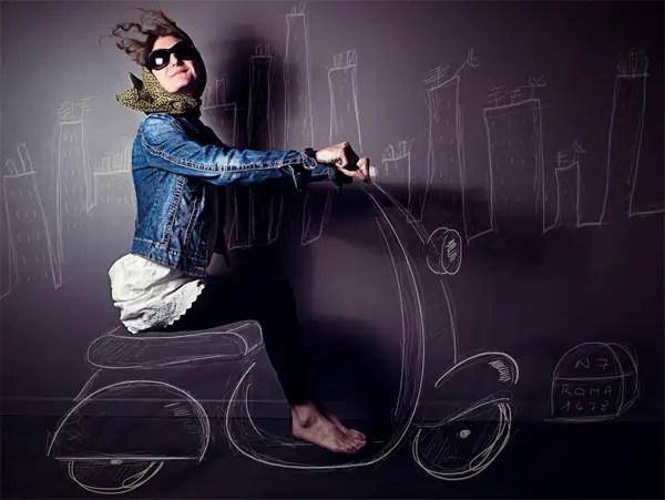 photo by ShmilebliK: a smiling girl driving a chalk bike